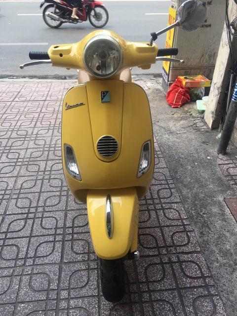 Piaggio Vespa Lx  125cc 2010 màu vàng bstp 9 chủ giá bán 14tr8